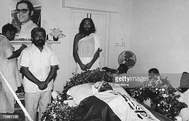 Indian Prime Minister Indira Gandhi's yogic mentor Dhirendra Brahmachari and others with the body of Gandhi's son Indian politician Sanjay Gandhi...