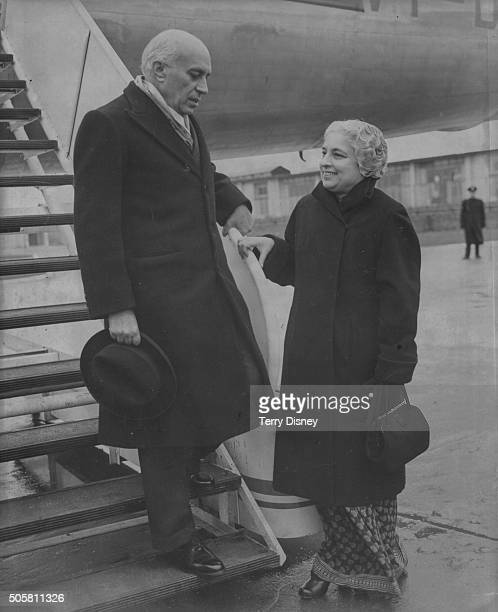 Indian Prime Minister Jawaharlal Nehru is greeted by his sister Vijaya Lakshmi Pandit Indian High Commissioner as he leaves his aircraft on arrival...