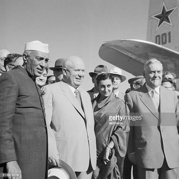 Indian Prime Minister Jawaharlal Nehru, left, welcomes visiting Russian leaders on their arrival at Palam Airport in the outskirts of here. Premier...