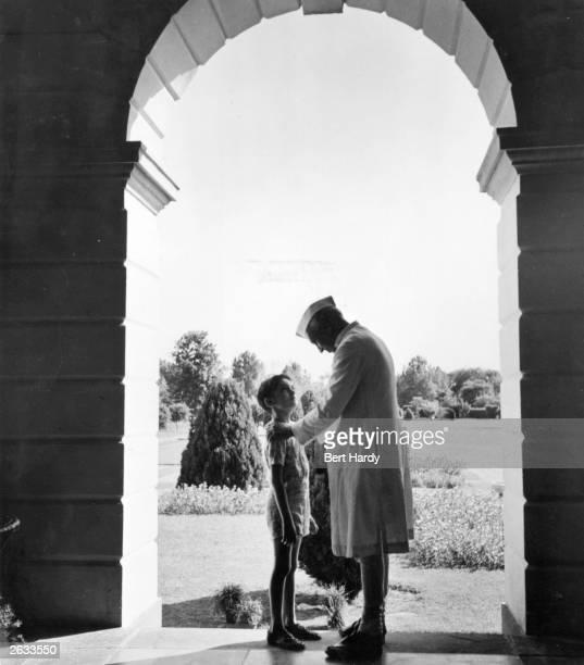 Indian prime minister Jawaharlal Nehru, or Pandit Nehru , with his grandson Rajiv Gandhi . Original Publication: Picture Post - 5141 - A Voice Above...