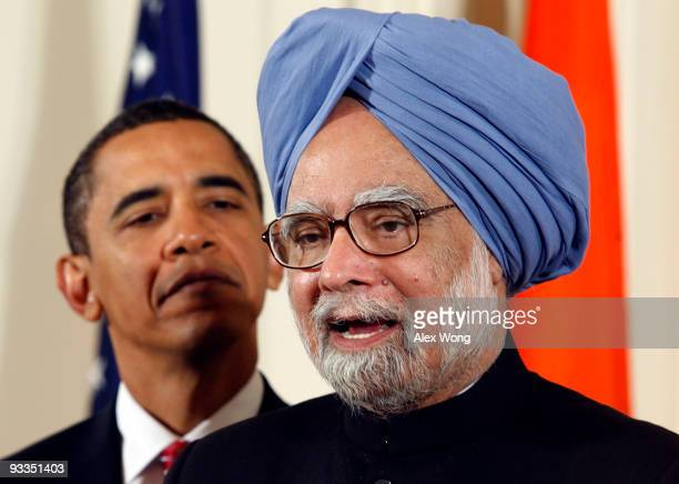 Indian Prime Minister Manmohan Singh , accompanied by U.S. President Barack Obama, speaks during a state arrival ceremony in the East Room of the...