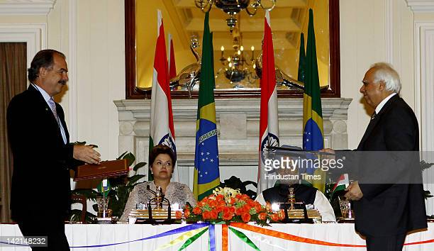Indian Prime Minister Manmohan Singh and Brazilian President Dilma Rousseff look on as India's Human Resource Development Minister Kapil Sibal and...