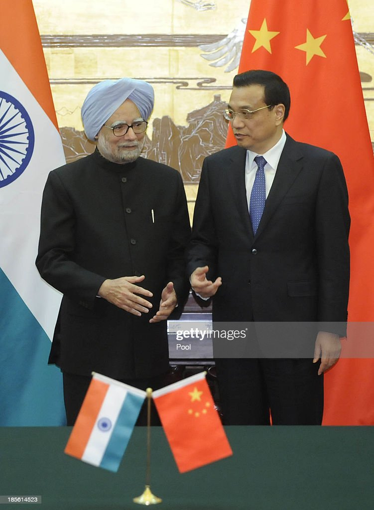 Indian Prime Minister Manmohan Singh and Chinese Premier Li Keqiang attend a signing ceremony at the Great Hall of the People on October 23, 2013 in Beijing, China. Singh is on a three-day visit to China to discuss various issues, including an agreement to sign a deal on border cooperation between the two countries.