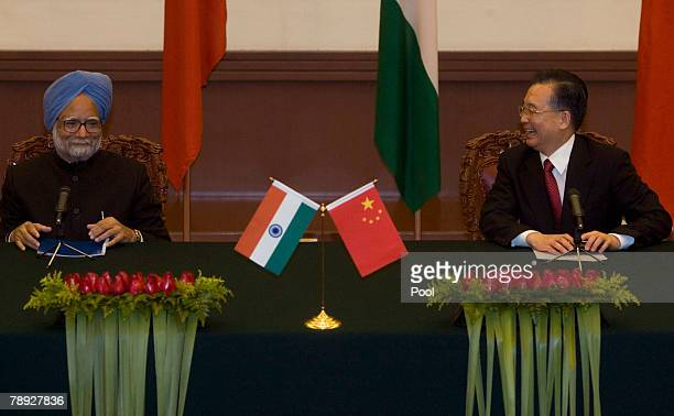 Indian Prime Minister Manmohan Singh and Chinese Premier Wen Jiabao attend a press conference after a signing ceremony held at the Great Hall of the...