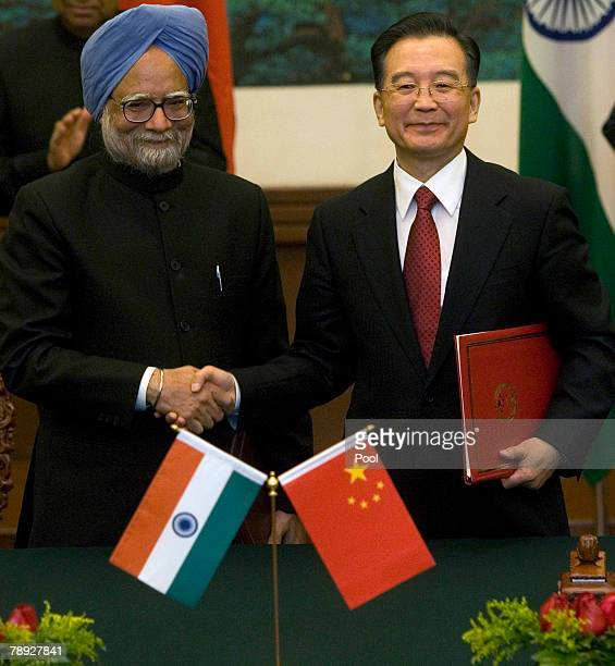 Indian Prime Minister Manmohan Singh and Chinese Premier Wen Jiabao shake hands after a signing ceremony held at the Great Hall of the People on...