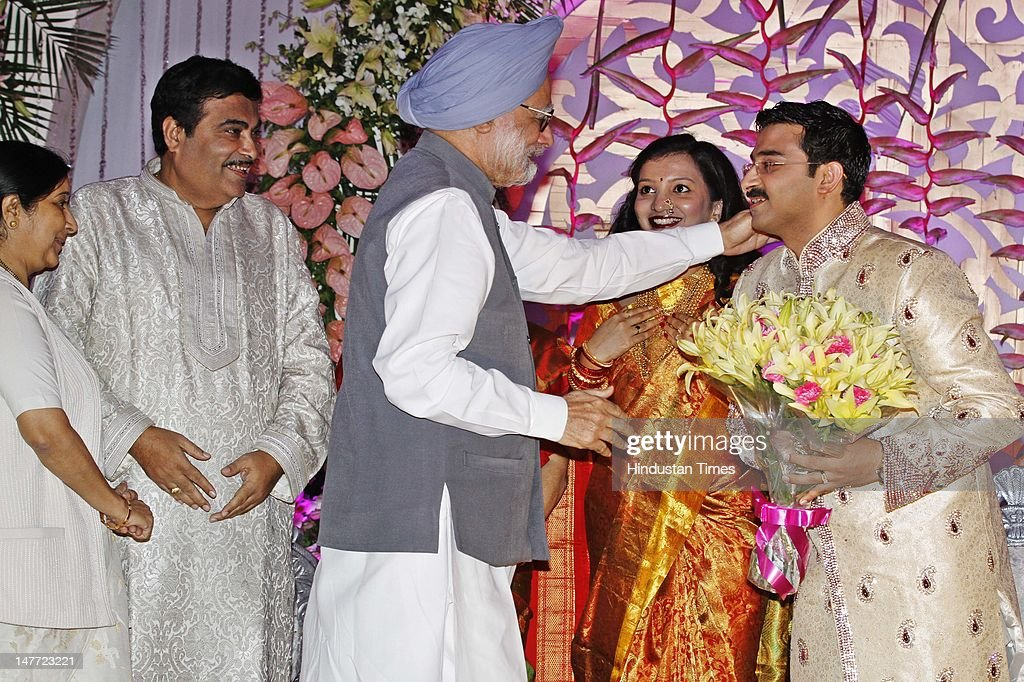 Indian Prime Minister Manmohan Singh blesses newlywed couple of Sarang Gadkari and Madhura during their wedding reception as BJP leaders Nitin Gadkari and Sushma Swaraj looks on July 2, 2012 in New Delhi, India. Sarang Gadkari tied knot with his classmate Madhura on June 24, 2012 in Nagpur.