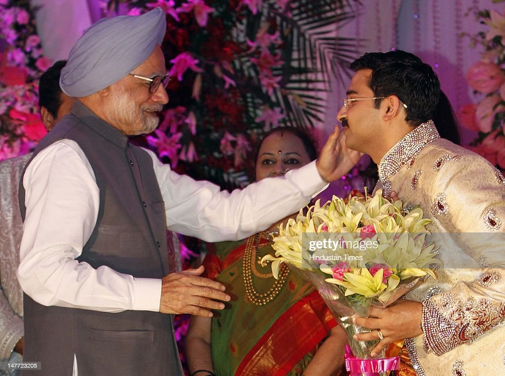 Indian Prime Minister Manmohan Singh blesses newlywed couple of BJP president Nitin Gadkar's son Sarang Gadkari and Madhura during their wedding reception on July 2, 2012 in New Delhi, India. Sarang Gadkari tied knot with his classmate Madhura on June 24, 2012 in Nagpur.