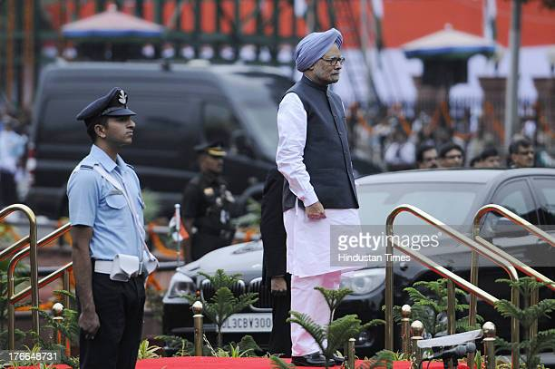 Indian Prime Minister Manmohan Singh inspects guard of honour before hoisting the national flag on the occasion of the 67th Independence Day at the...
