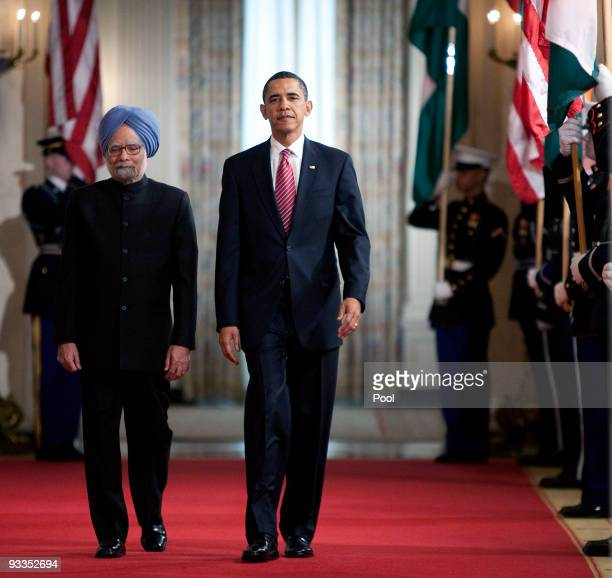 Indian Prime Minister Manmohan Singh , joined by U.S. President Barack Obama , arrives as they participate in a state arrival ceremony in the East...