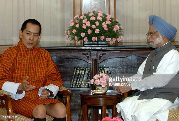 Indian Prime Minister Manmohan Singh listens as King Jigme Singye Wangchuck of Bhutan speaks during a meeting at Singh's residence in New Delhi 25...