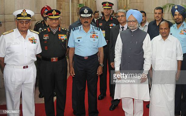 Indian Prime Minister Manmohan Singh meets with Indian Air Force Air Chief Marshal Norman Anil Kumar Browne Chief of the Indian Army General Vijay...