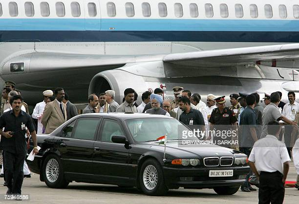 Indian Prime Minister Manmohan Singh steps into a car after his arrival by aircraft in Bangalore, 03 August 2007. Singh has arrived in the southern...