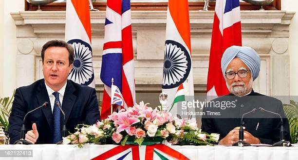 Indian Prime Minister Manmohan Singh with his British counterpart David Cameron address joint press conference after their delegation level meeting...