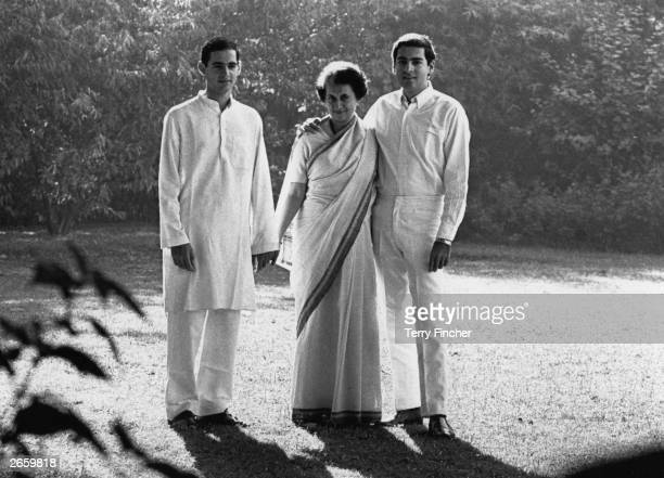 Indian prime minister Mrs Indira Gandhi with her two eldest sons Rajiv and Sanjay in the garden of their Delhi home