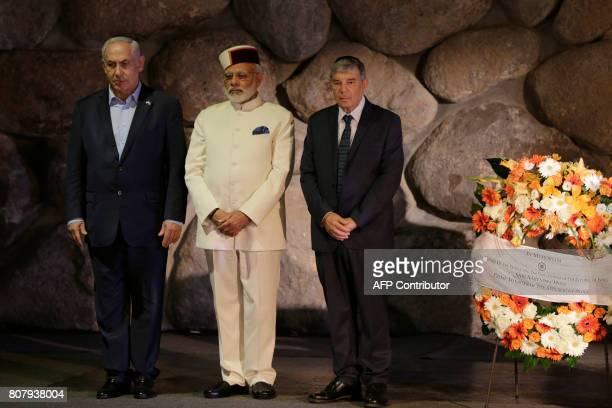 Indian Prime Minister Narendra Modi accompanied by Israeli Prime Minister Benjamin Netanyahu and Yad Vashem Chairman Avner Shalev stand at the 'Hall...