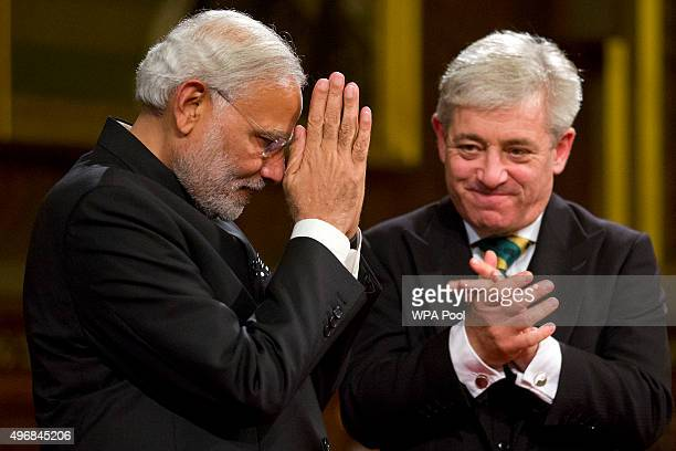 Indian Prime Minister Narendra Modi acknowledges applause next to Speaker of the House of Commons John Bercow after addressing members of parliament...