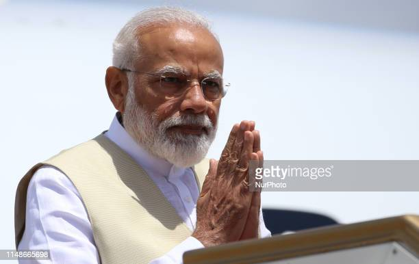 Indian Prime Minister Narendra Modi acknowledges the reception as he arrives at Bandaranaike International airport, Katunayake, Sri Lanka. Sunday 9...