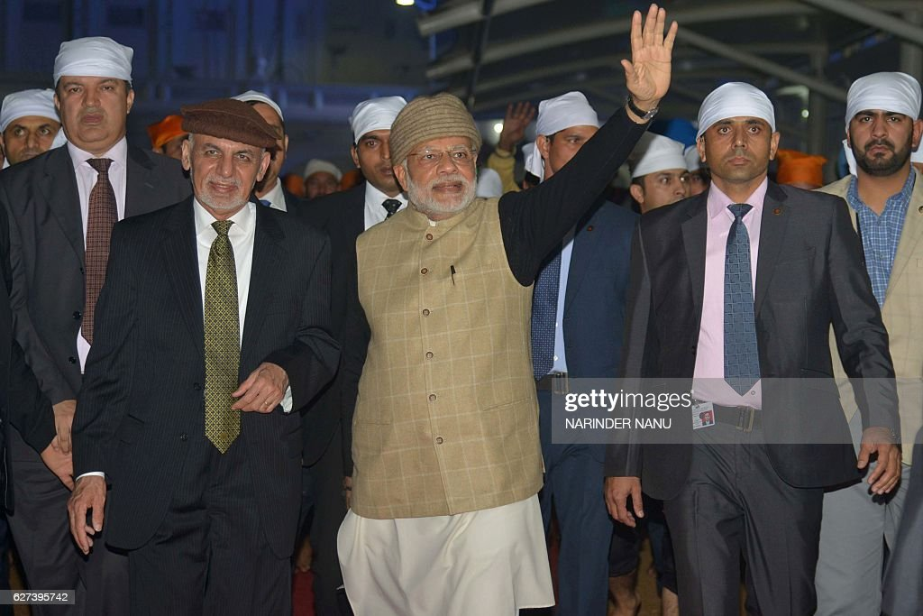 Indian Prime Minister Narendra Modi Afghan President Ashraf Ghani pay respects at the Golden temple in Amritsar on December 32016 Modi visited the...