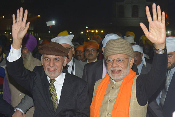 Indian Prime Minister Narendra Modi and Afghan President Ashraf Ghani gesture during their visit at the Golden temple in Amritsar on December 3 2016..