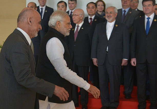 Indian Prime Minister Narendra Modi and Afghan President Ashraf Ghani arrive for the 6th Heart of Asia Ministerial Conference in Amritsar on December.