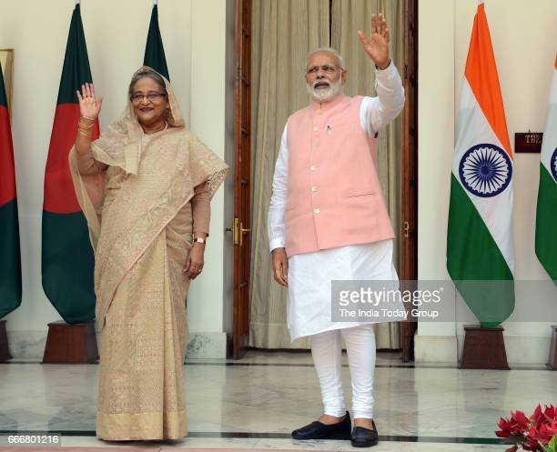 Indian Prime Minister Narendra Modi and Bangladesh Prime Minister Sheikh Hasina pose for the media prior to a meeting in New Delhi