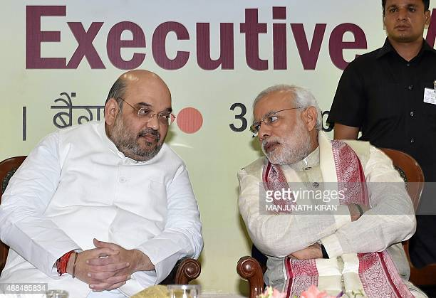 Indian Prime Minister Narendra Modi and Bharatiya Janata Party National President Amit Shah speak at a BJP National Executive committee meeting in...