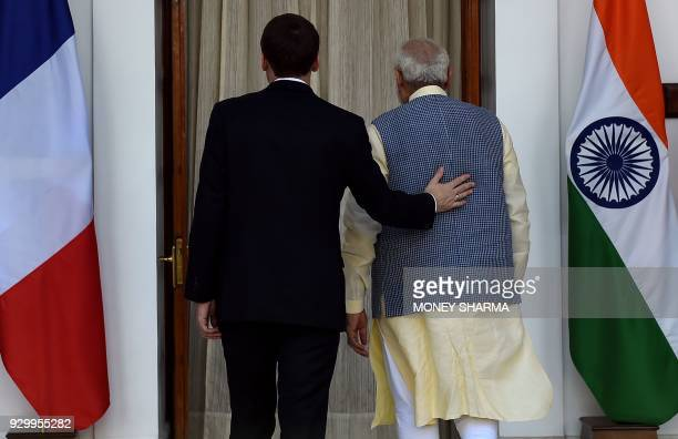 Indian Prime Minister Narendra Modi and France's President Emmanuel Macron leave for a meeting at Hyderabad House in New Delhi on March 10 2018...