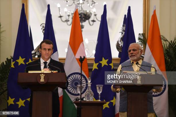 Indian Prime Minister Narendra Modi and French President Emmanuel Macron take part in a joint press conference in New Delhi on March 10 2018 French...