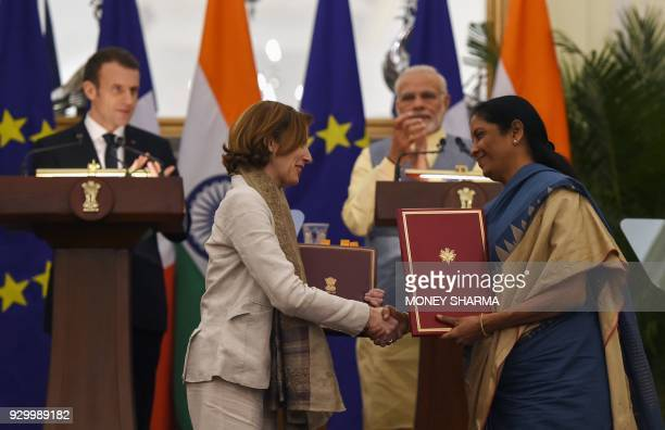 Indian Prime Minister Narendra Modi and French President Emmanuel Macron watch as Indian Defence Minister Nirmala Sitharaman and French Defense...