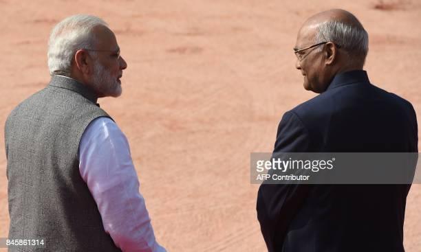 Indian Prime Minister Narendra Modi and Indian President Ram Nath Kovind look on during a ceremonial reception for Belarus President Alexander...