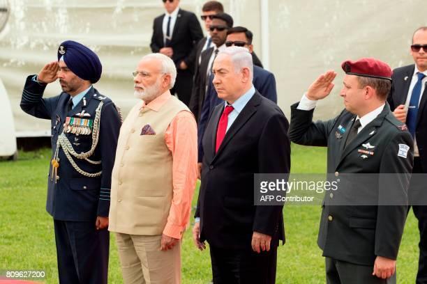 Indian Prime Minister Narendra Modi and Israeli Prime Minister Benjamin Netanyahu stand between Indian and Israeli army officers at the Indian Army...