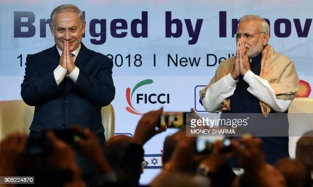Indian Prime Minister Narendra Modi and Israeli Prime Minister Benjamin Netanyahu greet during the IndiaIsrael Business Summit in New Delhi on...