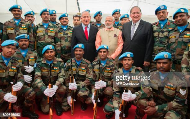 Indian Prime Minister Narendra Modi and Israeli Prime Minister Benjamin Netanyahu pose for a picture with members of the Indian contingent of UNIFIL...