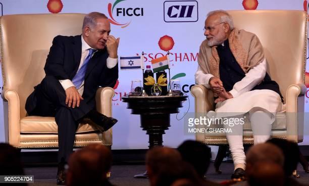 Indian Prime Minister Narendra Modi and Israeli Prime Minister Benjamin Netanyahu talk during the IndiaIsrael Business Summit in New Delhi on January...