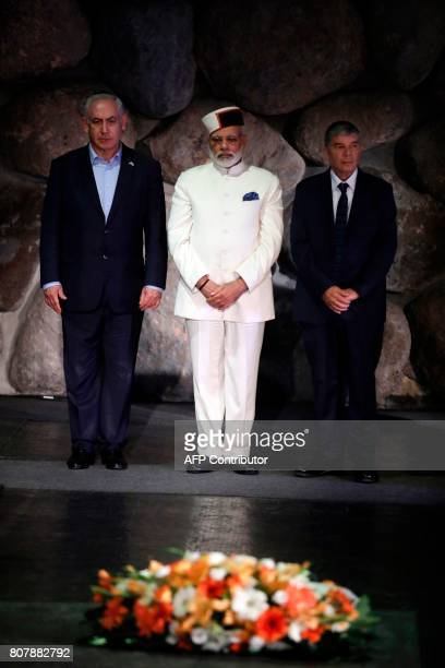 Indian Prime Minister Narendra Modi and Israel's Prime Minister Benjamin Netanyahu attend a wreath laying ceremony during a visit to the Yad Vashem...