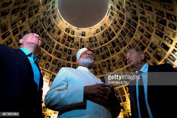 Indian Prime Minister Narendra Modi and Israel's Prime Minister Benjamin Netanyahu look at pictures of Jewish Holocaust victims on July 4 at the Hall...