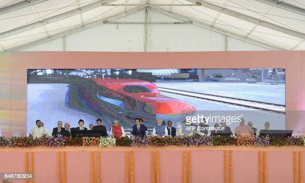 Indian Prime Minister Narendra Modi and Japanese Prime Minister Shinzo Abe look on during a ground breaking ceremony for the MumbaiAhmedabad high...
