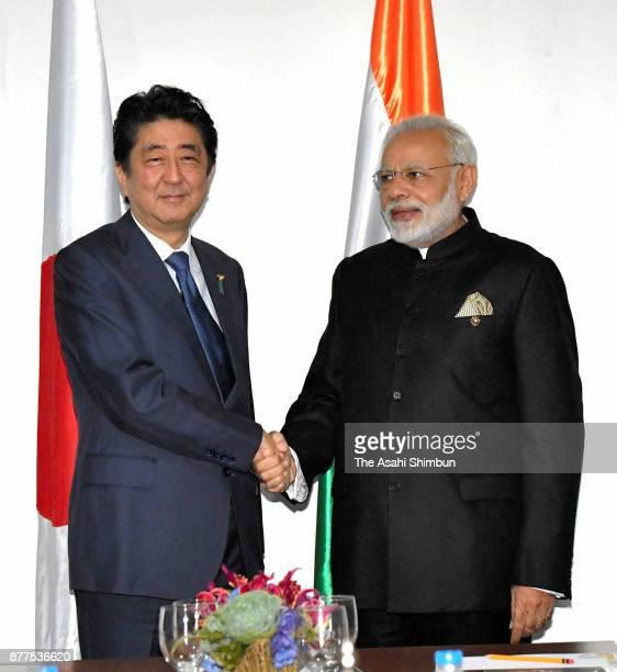 Indian Prime Minister Narendra Modi and Japanese Prime Minister Shinzo Abe shake hands prior to their meeting on November 14 2017 in Manila...