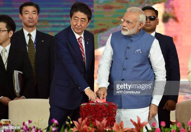 Indian Prime Minister Narendra Modi and Japan's Prime Minister Shinzo Abe push switches during a ground breaking ceremony for the MumbaiAhmedabad...