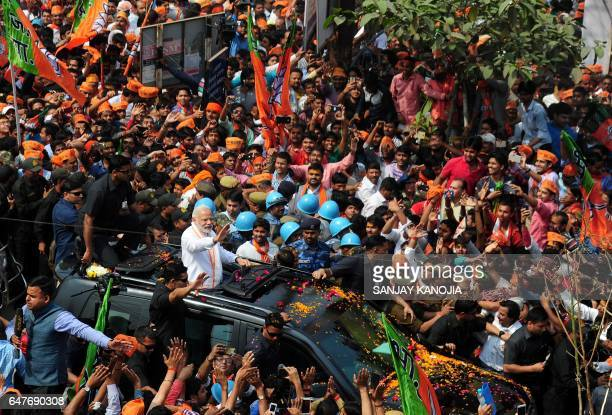 Indian Prime Minister Narendra Modi and leader of the Bharatiya Janata Party gestures during a roadshow in support of their state assembly election...