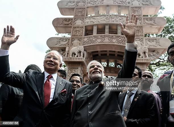 Indian Prime Minister Narendra Modi and Malaysia's Prime Minister Najib Razak wave after inaugurating the 'Torana Gate ' symbolising MalaysiaIndia...