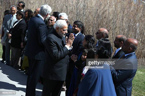 TORONTO ON APRIL 16 Indian Prime Minister Narendra Modi and Prime Minister Stephen Harper greet families of the victims of Flight 182 near the...