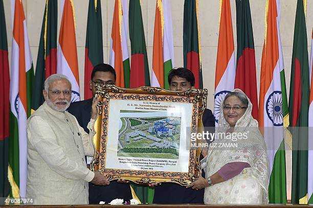 Indian Prime Minister Narendra Modi and Sheikh Hasina Wajid hold a graphical image of 1320 MW Rampal Power Plant a Bangladesh India Friendship Power...