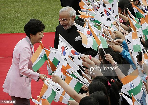 Indian Prime Minister Narendra Modi and South Korean President Park GeunHye are greeted by South Korean elementary school students during a welcoming...