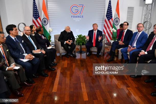 Indian Prime Minister Narendra Modi and US President Donald Trump speak during a bilateral meeting in Biarritz southwest France on August 26 on the...