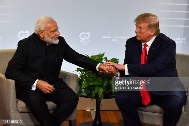 Indian Prime Minister Narendra Modi and US President Donald Trump shakes hands as they speak during a bilateral meeting in Biarritz, south-west...