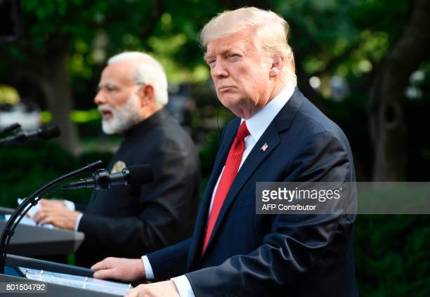 Indian Prime Minister Narendra Modi and US President Donald Trump speak to the press in the Rose Garden of the White House in Washington DC on June...