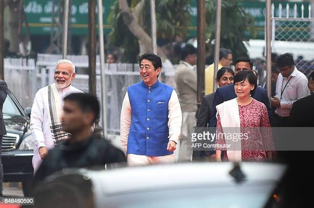 Indian Prime Minister Narendra Modi arrives with Japanese Prime Minister Shinzo Abe and his wife Akie Abe for dinner at a traditional Indian...