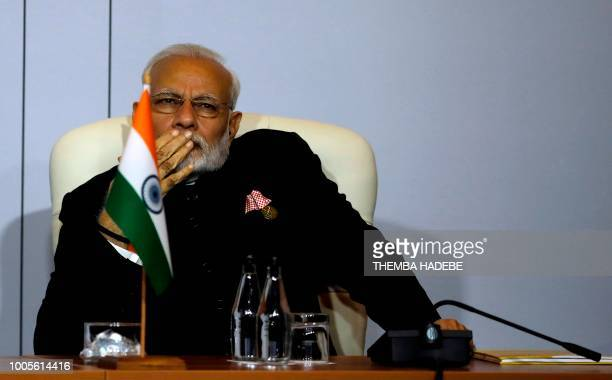 Indian Prime Minister Narendra Modi attends the open session meeting of the 10th BRICS summit on July 26, 2018 at the Sandton Convention Centre in...
