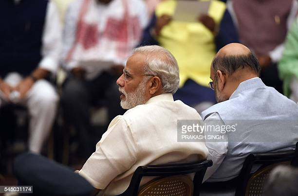 Indian Prime Minister Narendra Modi attends the swearingin ceremony of new cabinet ministers following his cabinet reshuffle at the Presidential...